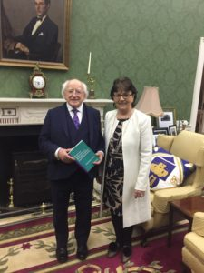 Jacinta Kitt, author of 'Positive Behaviours, Relationships and Emotions: The Heart of Leadership in a School', presenting her book to President Michael D Higgins.