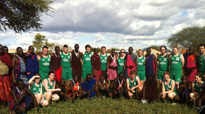 Laura Finnegan, Jean McArdle, and Emma Saunders, with a group of WIT students who were in Tanzania to play football against the Maasai.